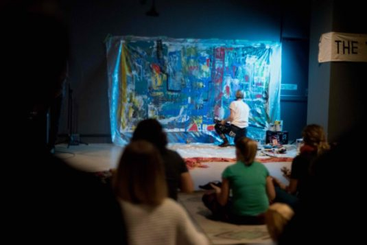 Claire creating a live painting to The Just band at the 5 Senses Event created by the Yoga Chapple, hosted at Gallery Stratford, 2019